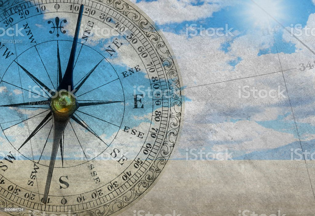 Multiple Exposure Of Compass And Scene From Remote Desert stock photo