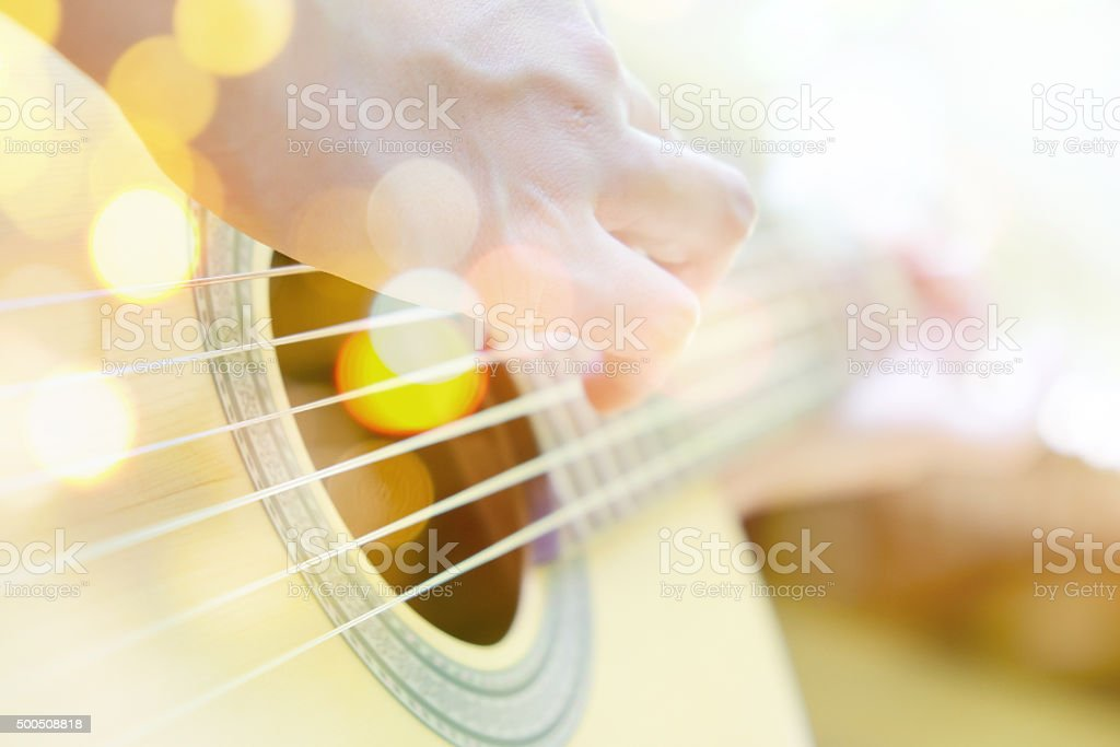 Multiple exposure of guitar player stock photo
