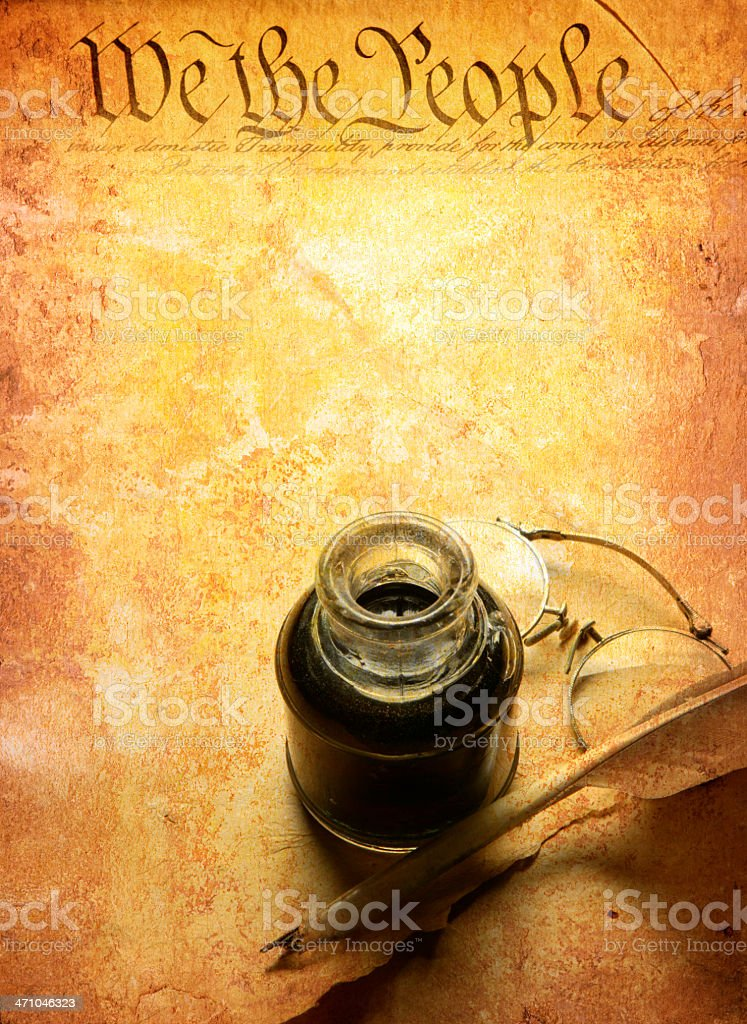 Multiple exposure of quill and inkwell and U.S. Constitution stock photo