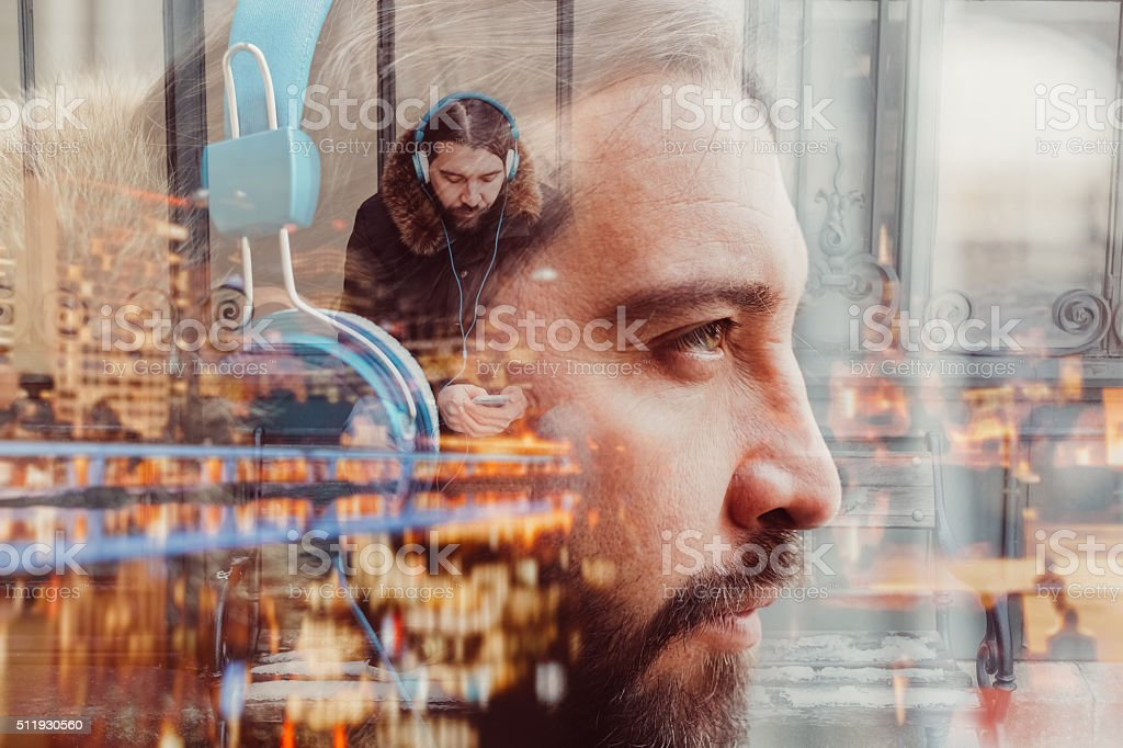 Multiple exposure photo of man with headphones stock photo