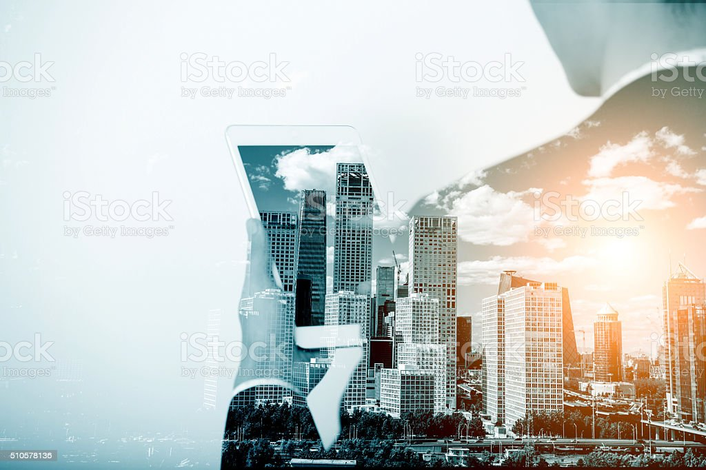 Multiple exposure with businessman using digital tablet stock photo