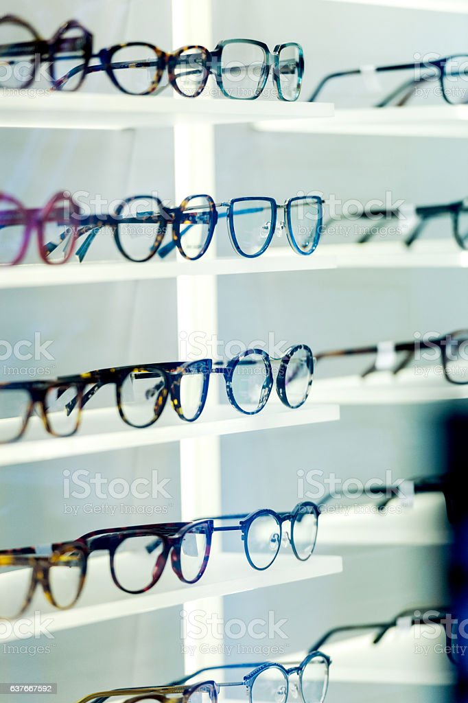 Multiple eyeglasses frames in optical store stock photo