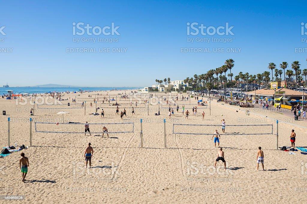 Multiple games of beach volleyball at Huntington Beach, California stock photo