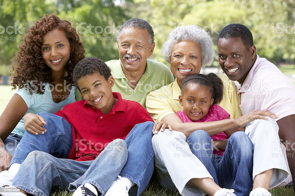 Multiple generations gather for family photo stock photo