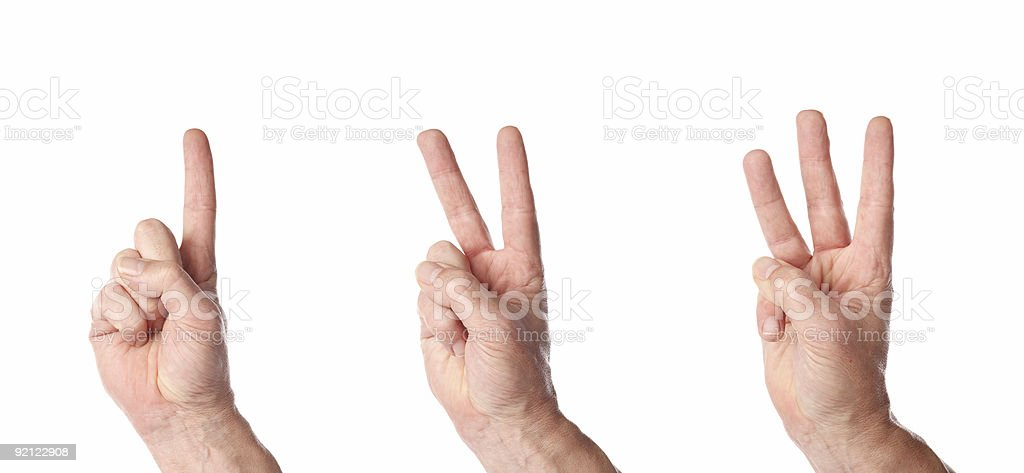 Multiple hands counting up to the number three stock photo