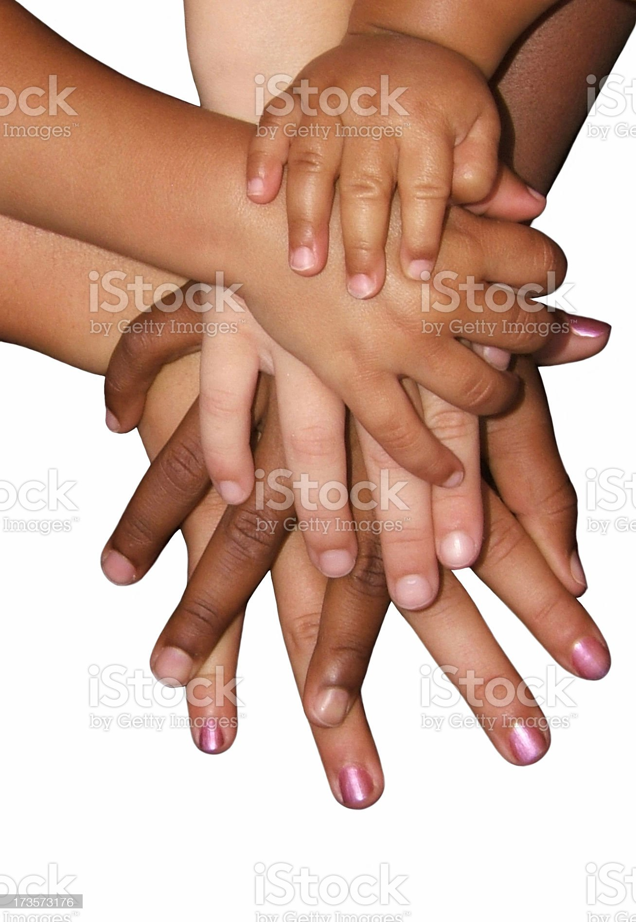 Multiple hands on top of each other on white surface royalty-free stock photo