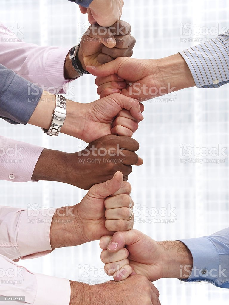 Multiple hands stacked royalty-free stock photo