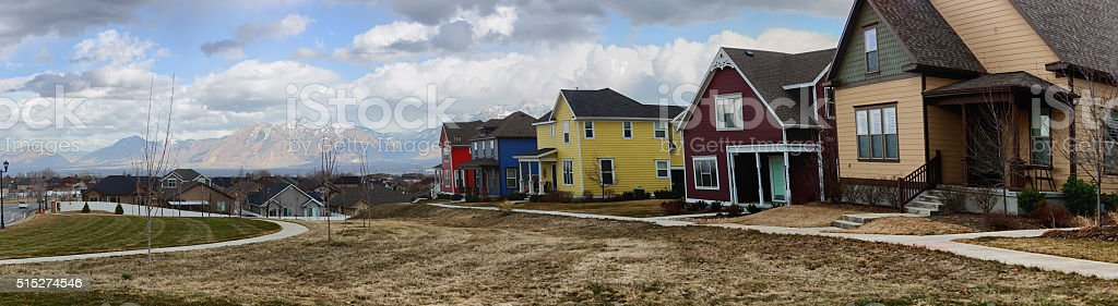 Multiple Houses Near a Park in Utah with Mountains stock photo