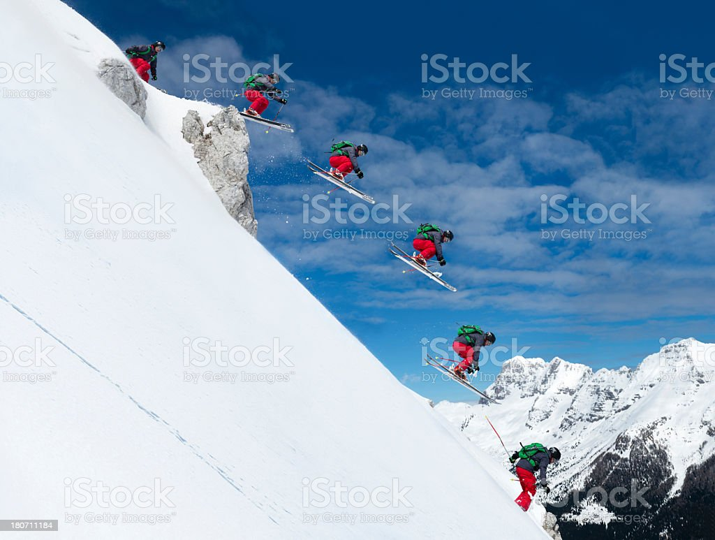 Multiple Image of Free Ride Skier Jumping Over the Rock stock photo