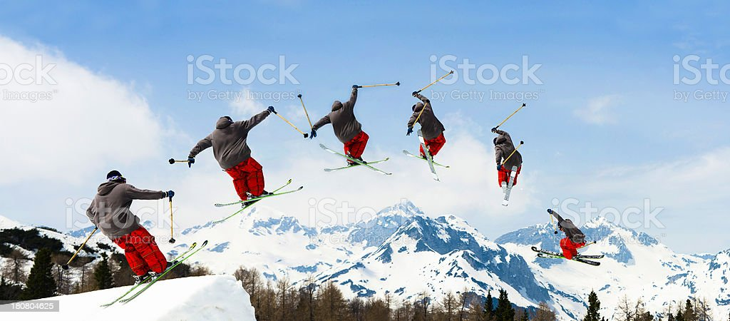 Multiple Image of Free Style Skier Jumping Over the Hill stock photo
