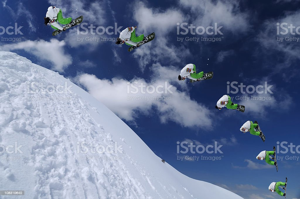Multiple image of snowboarder in mid air stock photo