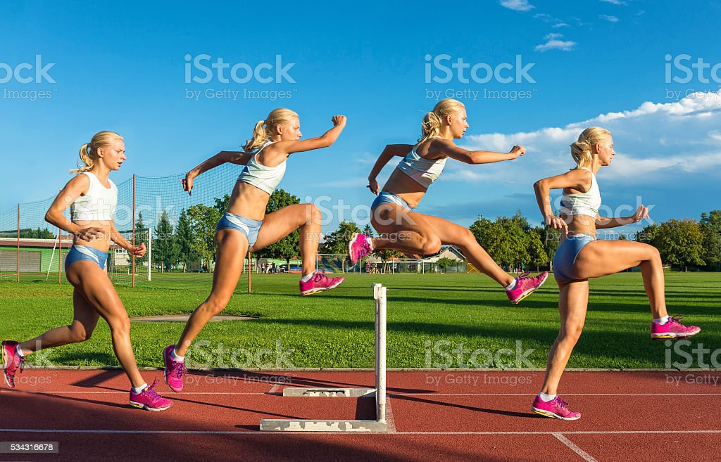 Multiple Image of  Young Women Racing 100m Hurdles stock photo