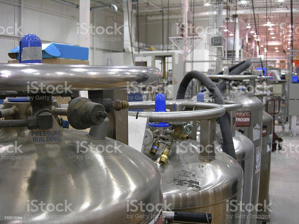 Multiple Industrial Nitrogen Tanks inside an industry stock photo