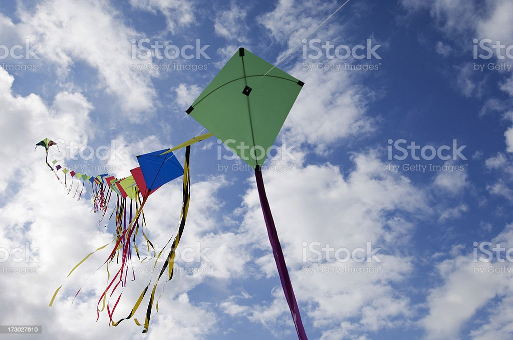Multiple Kites  Flying In a Bright Blue Summer Sky stock photo