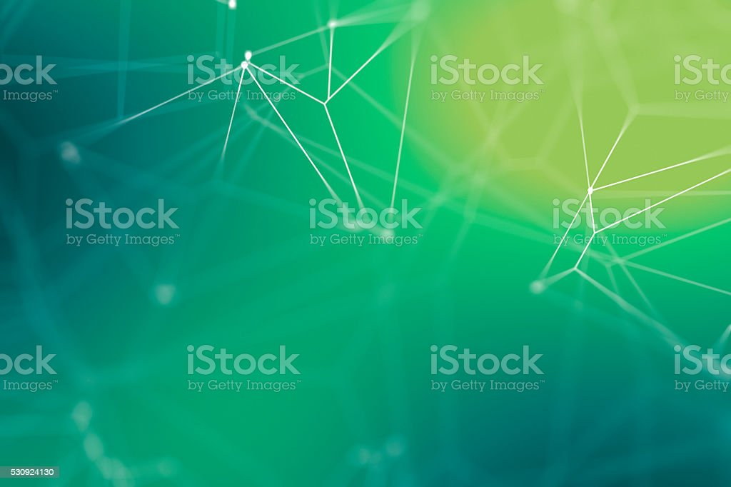 Multiple lines connected by dots against a blury background stock photo