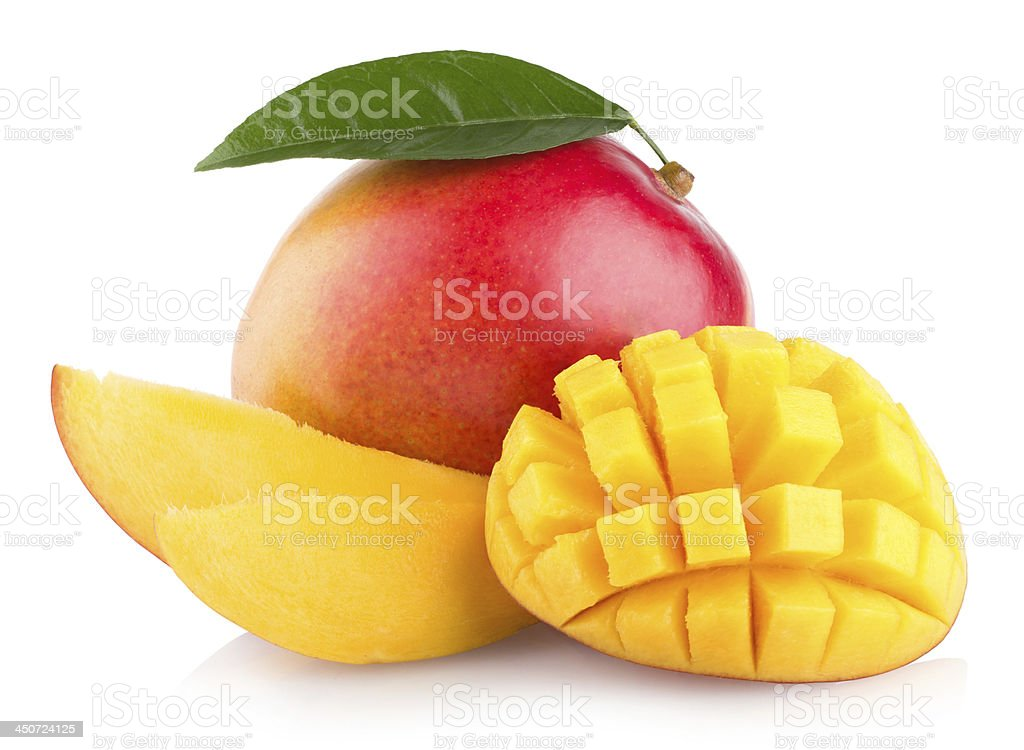 Multiple mangos One cut and one sliced in a pattern stock photo