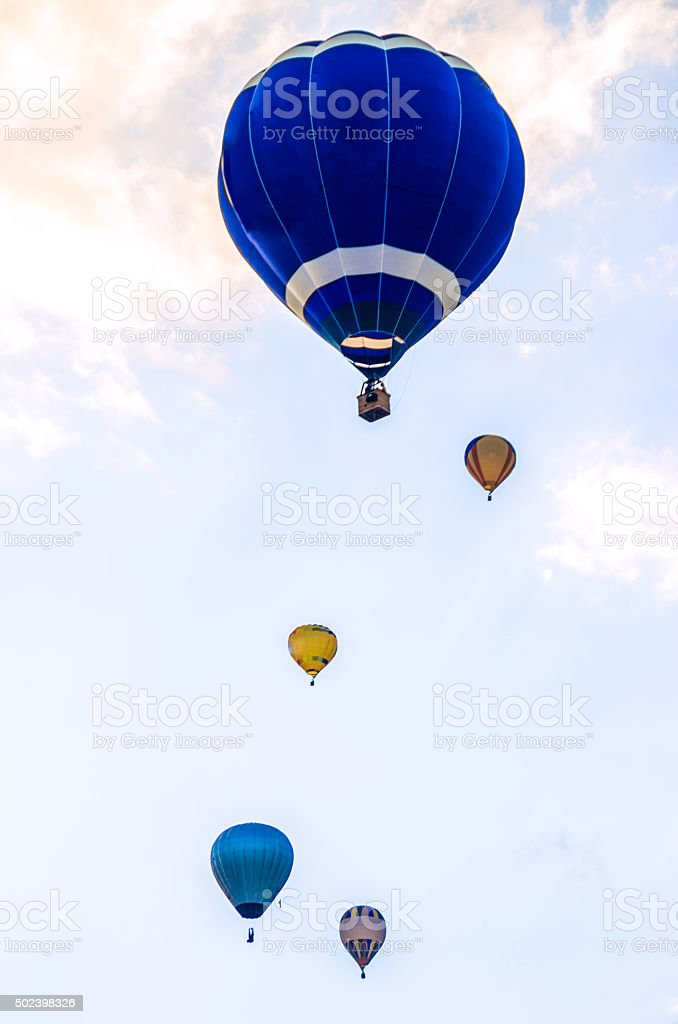 multiple many five hot air balloon flying sky vertical stock photo