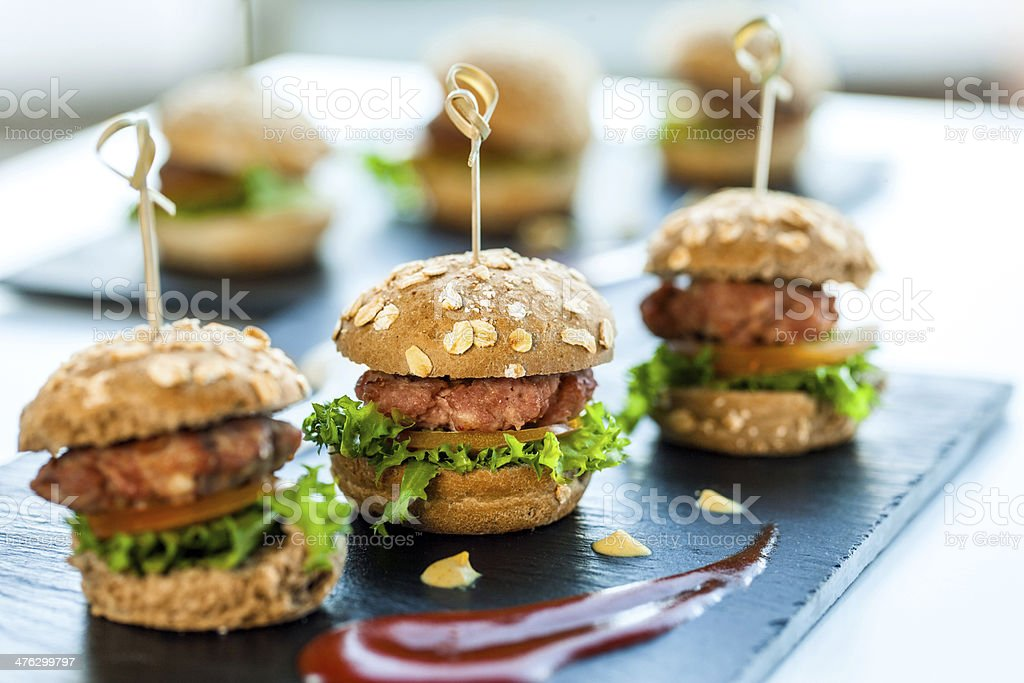 Multiple min beef hamburgers. stock photo