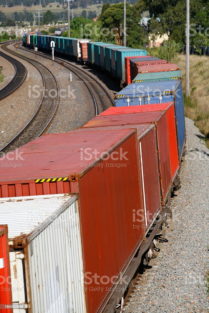 Multiple multicolored containers of a container train stock photo