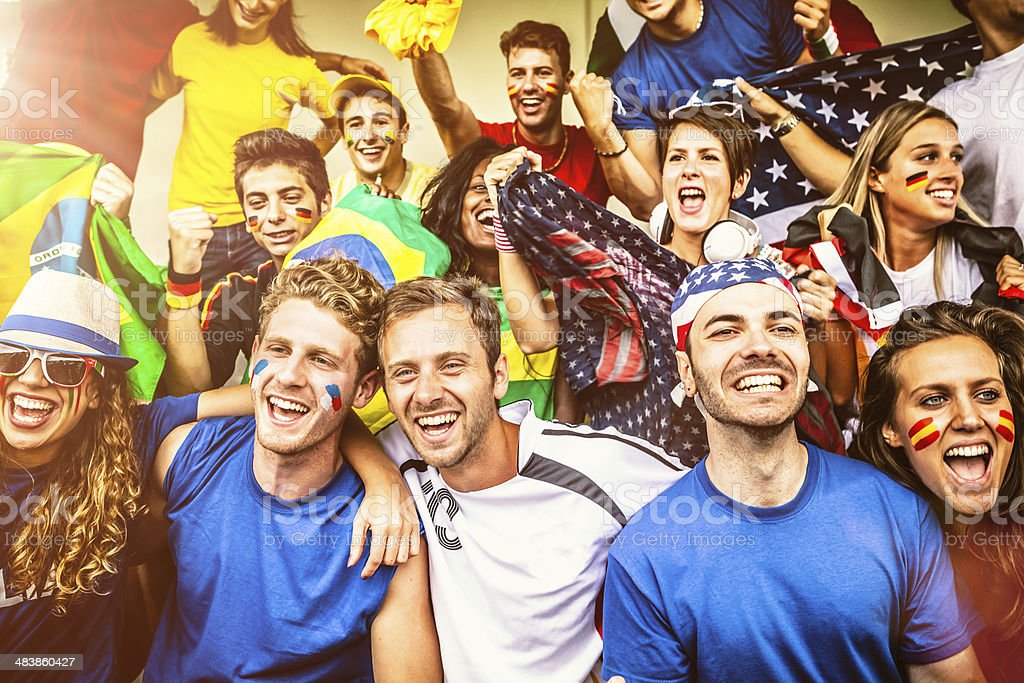 Multiple nations' fans at soccer stadium stock photo