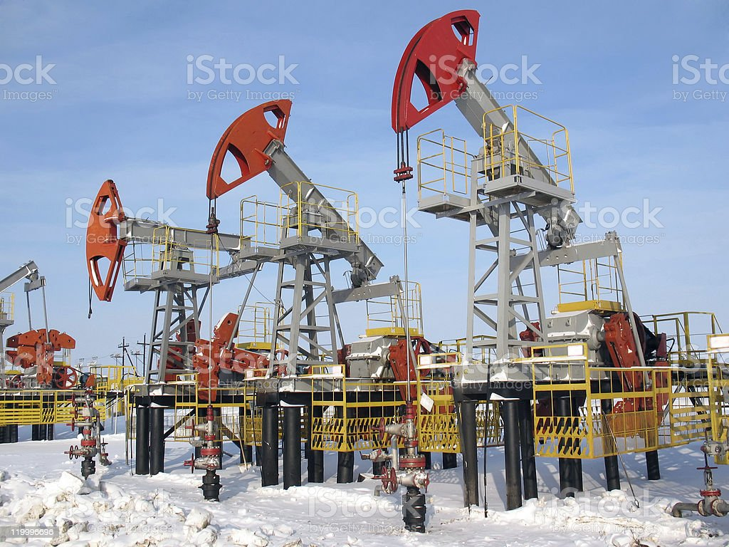 Multiple oil pumps in a oil field royalty-free stock photo