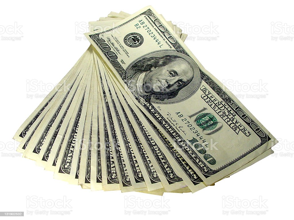 Multiple one hundred dollar bills laid out fan style stock photo