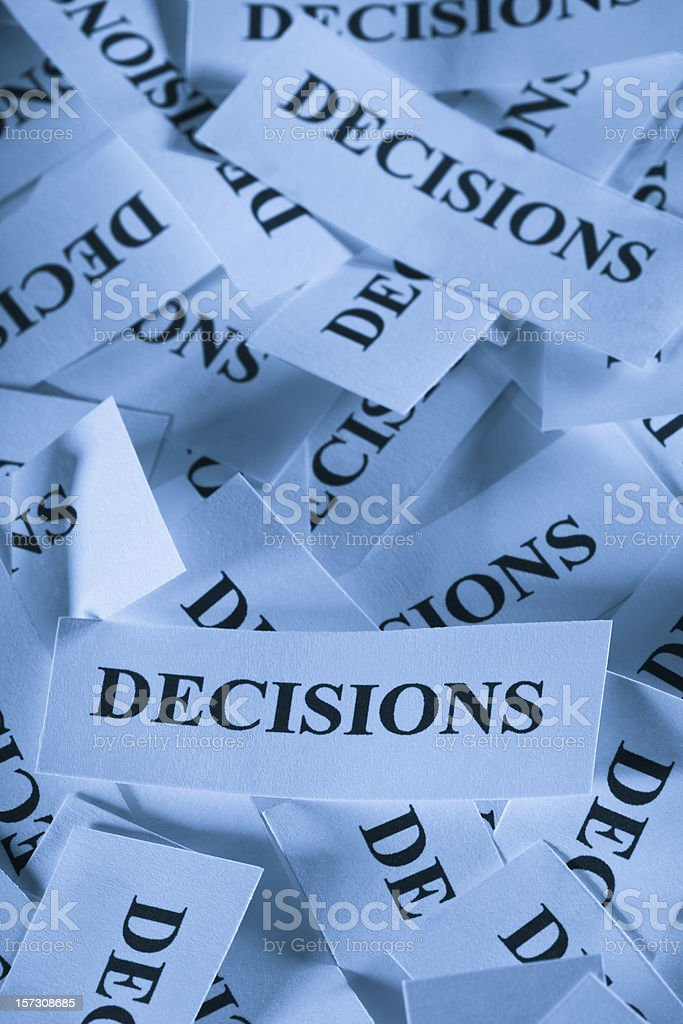 Multiple pieces of paper that are labelled with 'decisions' royalty-free stock photo