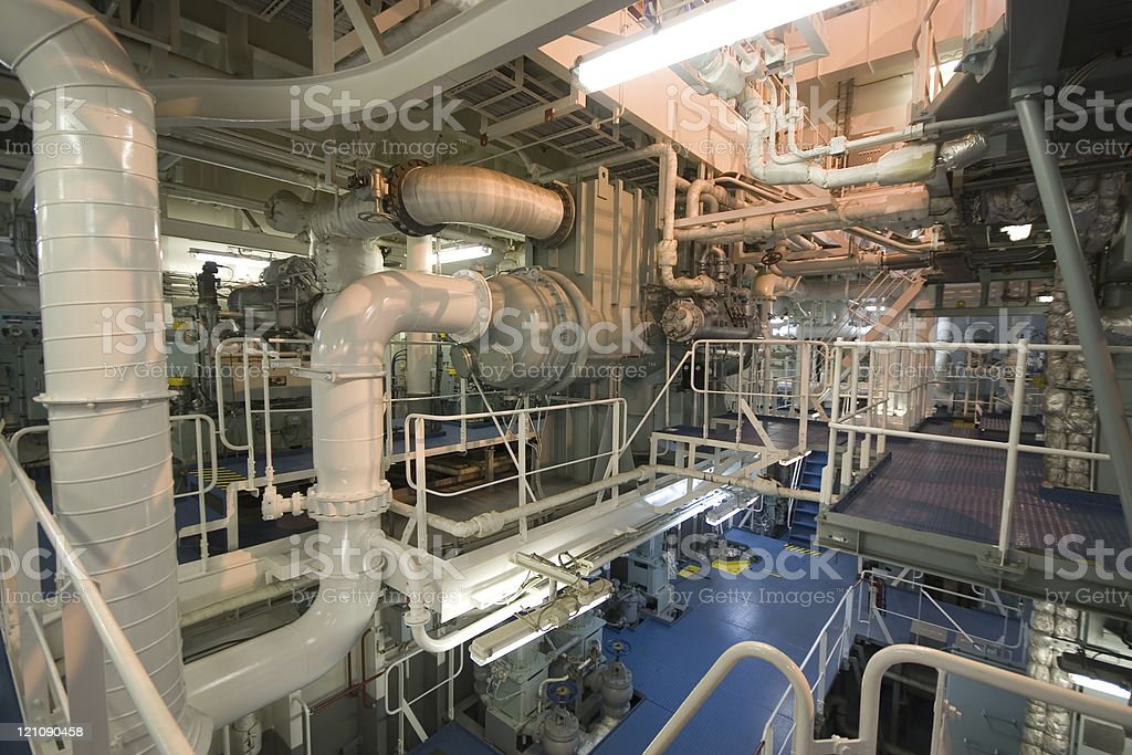 Multiple pipes leading in multiple directions in engine room stock photo