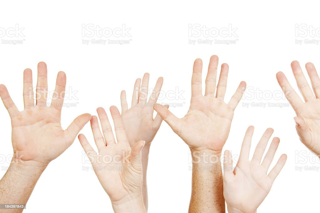 Multiple raised hands on white royalty-free stock photo