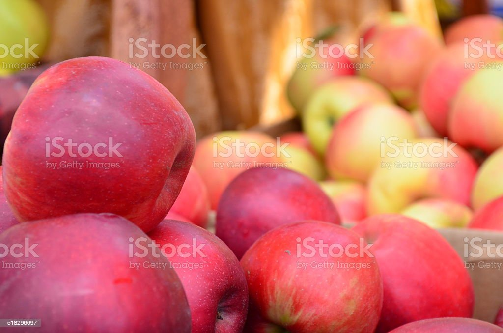 Multiple red apples for sale at an outdoor market. stock photo