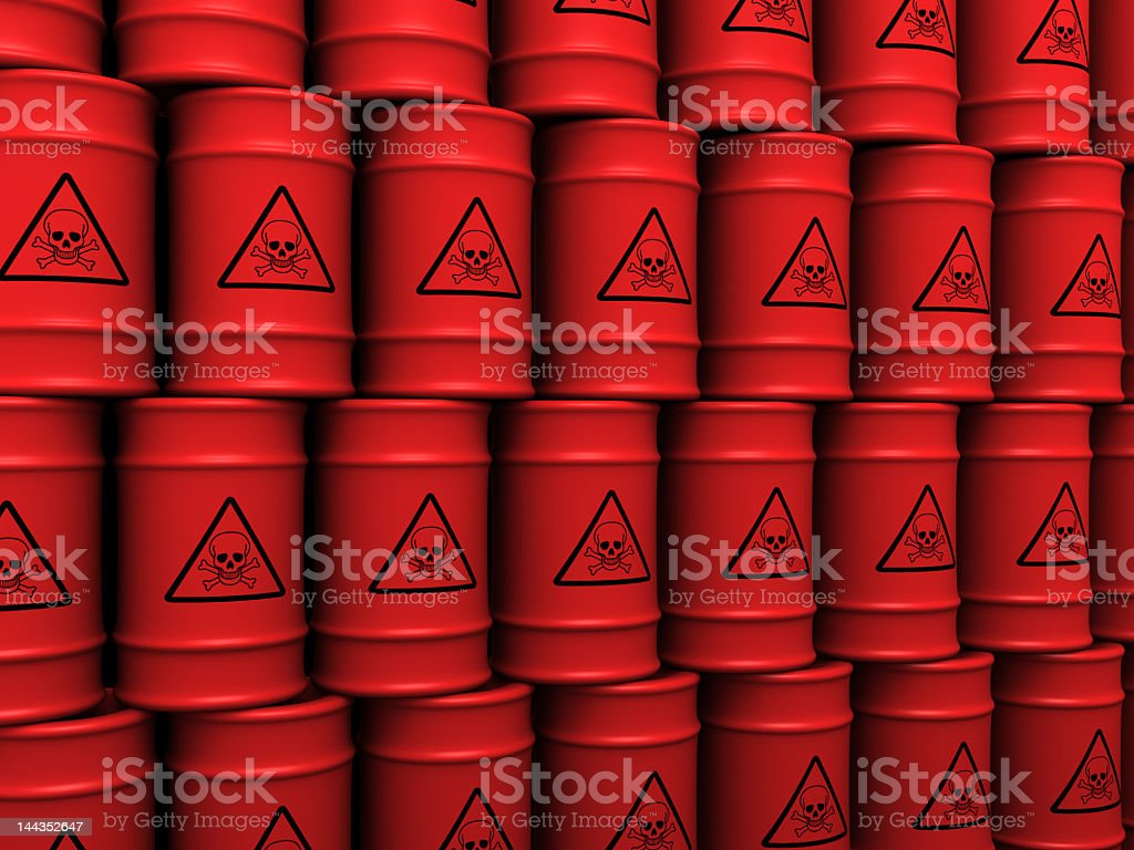 Multiple red toxic waste barrels stacked up in order stock photo