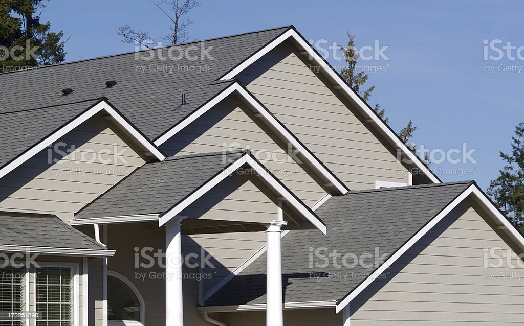 Multiple Roof Peaks on New Home Construction royalty-free stock photo