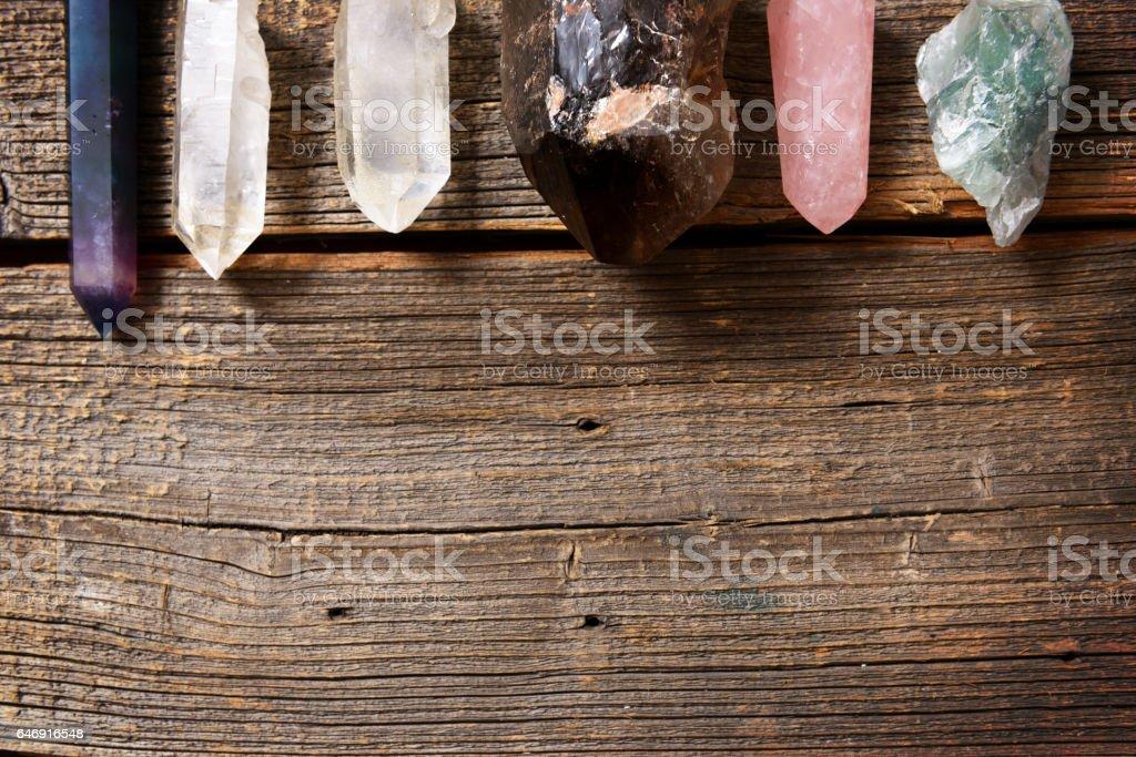 Multiple semi precious gemstones on board stock photo
