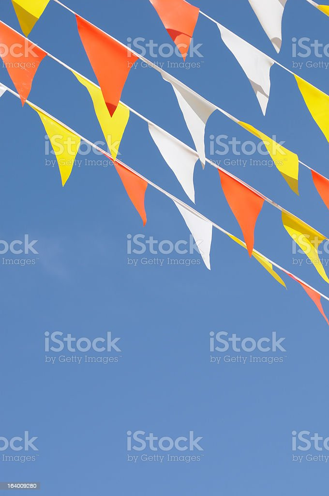 Multiple Strings, Colorful, Triangular Banner Flags, Clear Blue Sky, Horizontal royalty-free stock photo