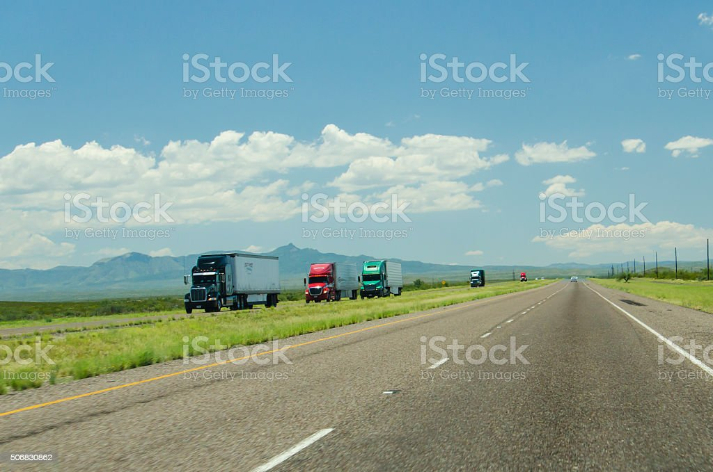 Multiple Truck Trailers Driving on Highway in New Mexico stock photo