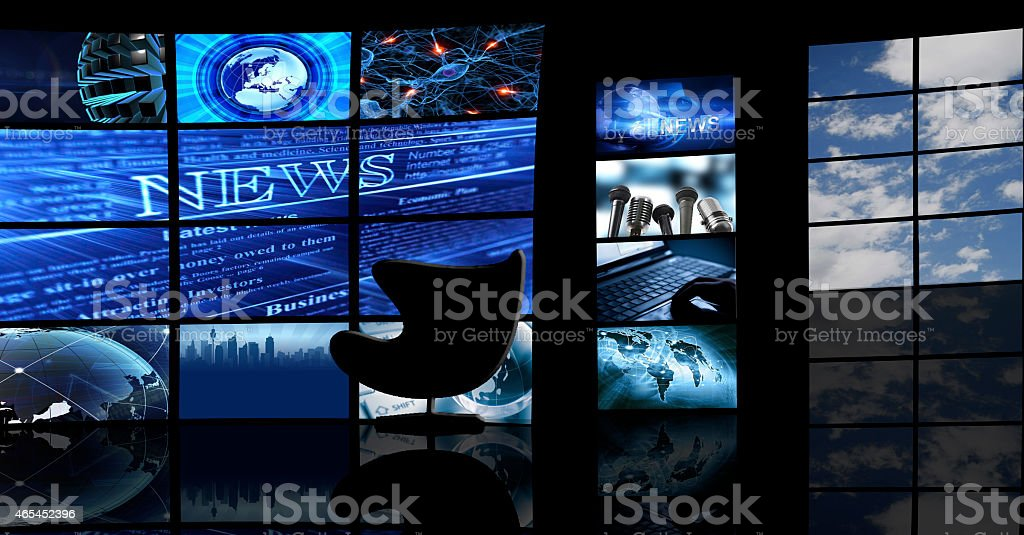 Multiple TV screens display news in a dark studio stock photo