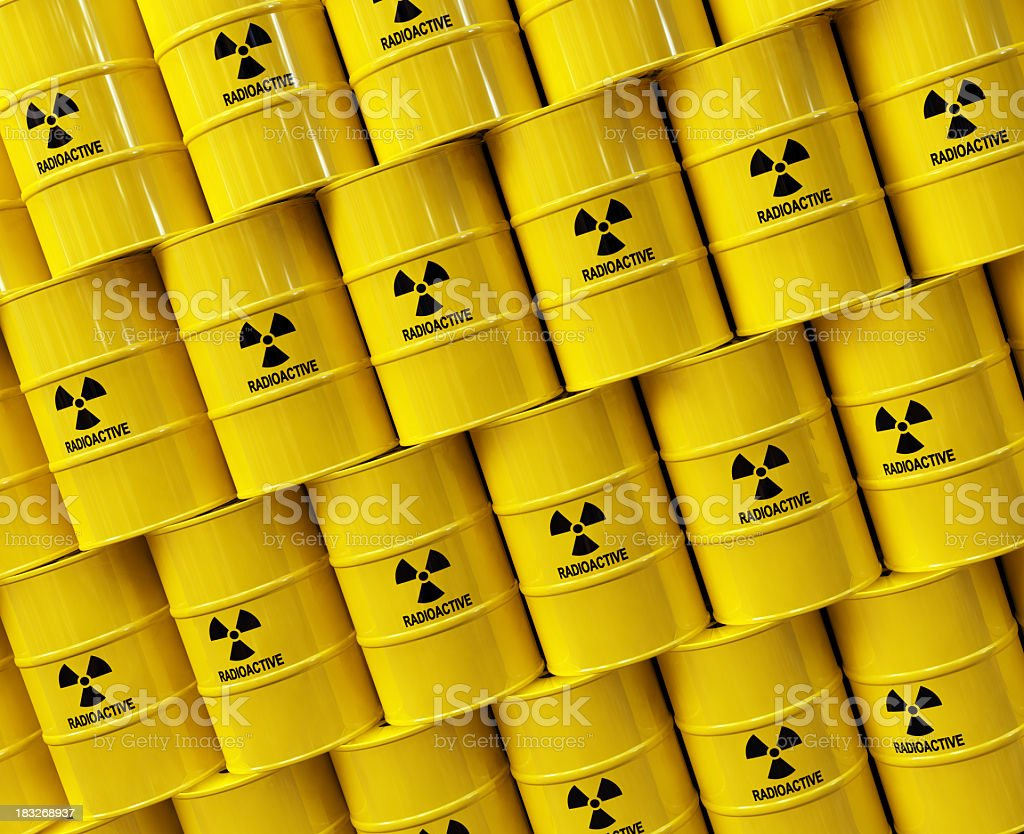 Multiple yellow barrels of nuclear waste stock photo