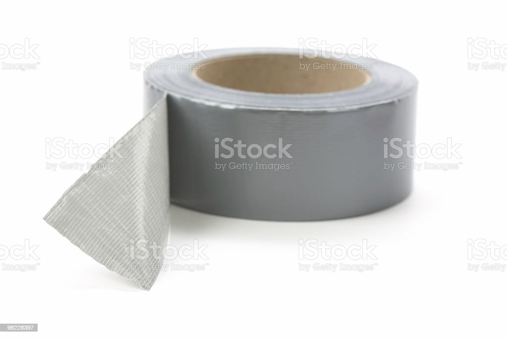 Multi-purpose duct tape in gray on a white background stock photo