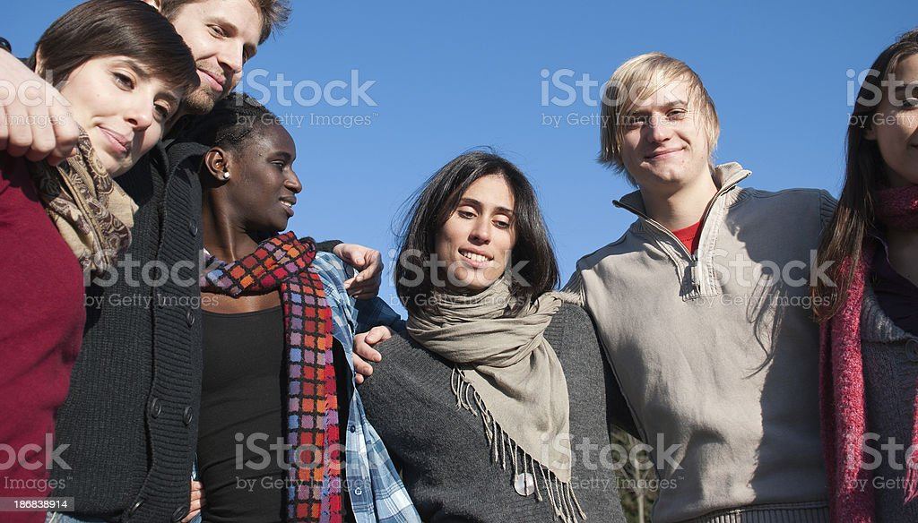 Multiracial adult - Embrace together royalty-free stock photo