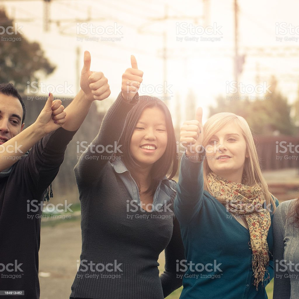 Multiracial adult - thumbs up royalty-free stock photo