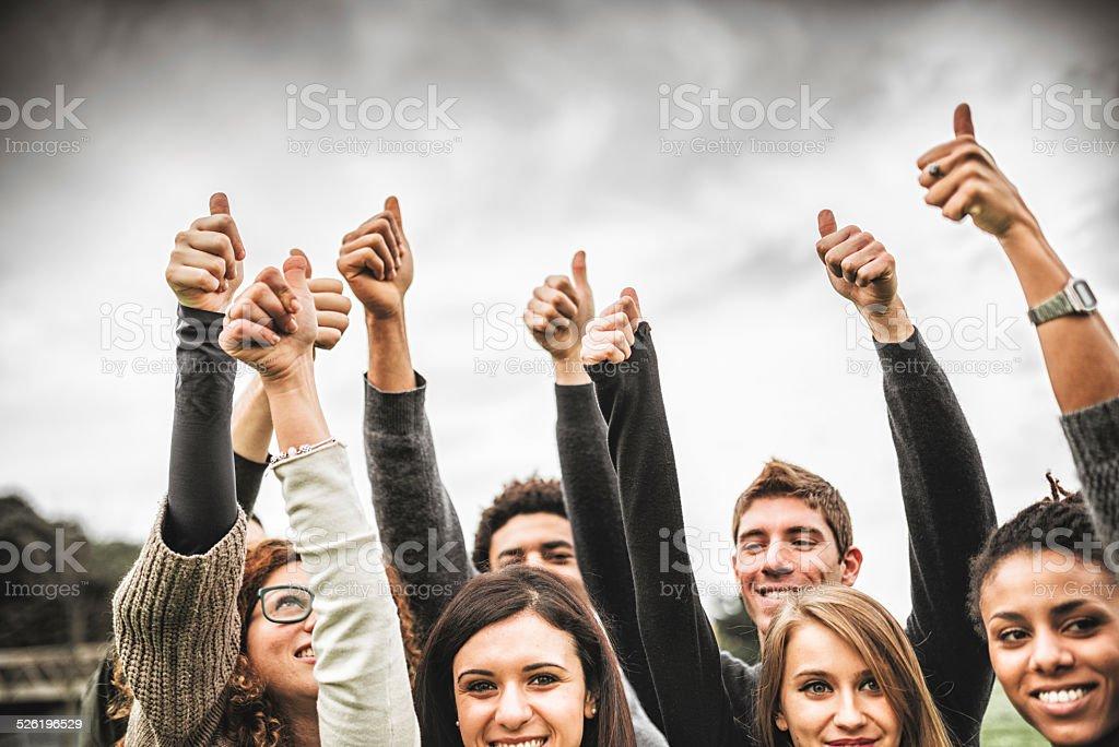 Multiracial adult - thumbs up stock photo