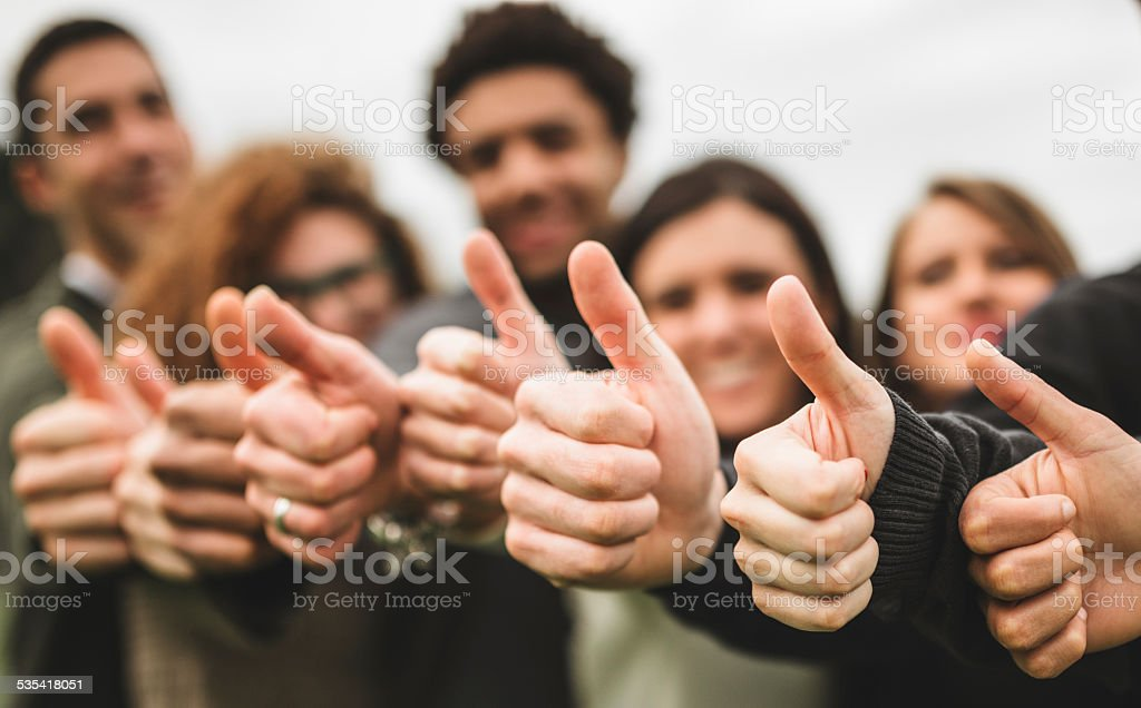 Multiracial adult - thumbs up stock photo