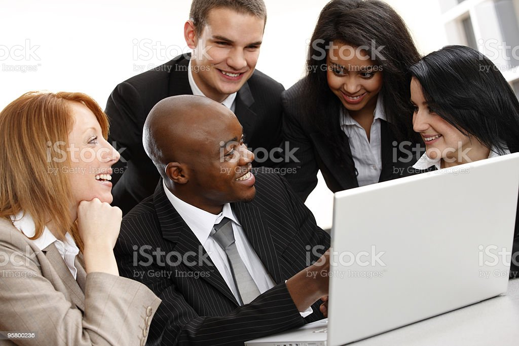 multiracial Business colleagues working on a laptop royalty-free stock photo