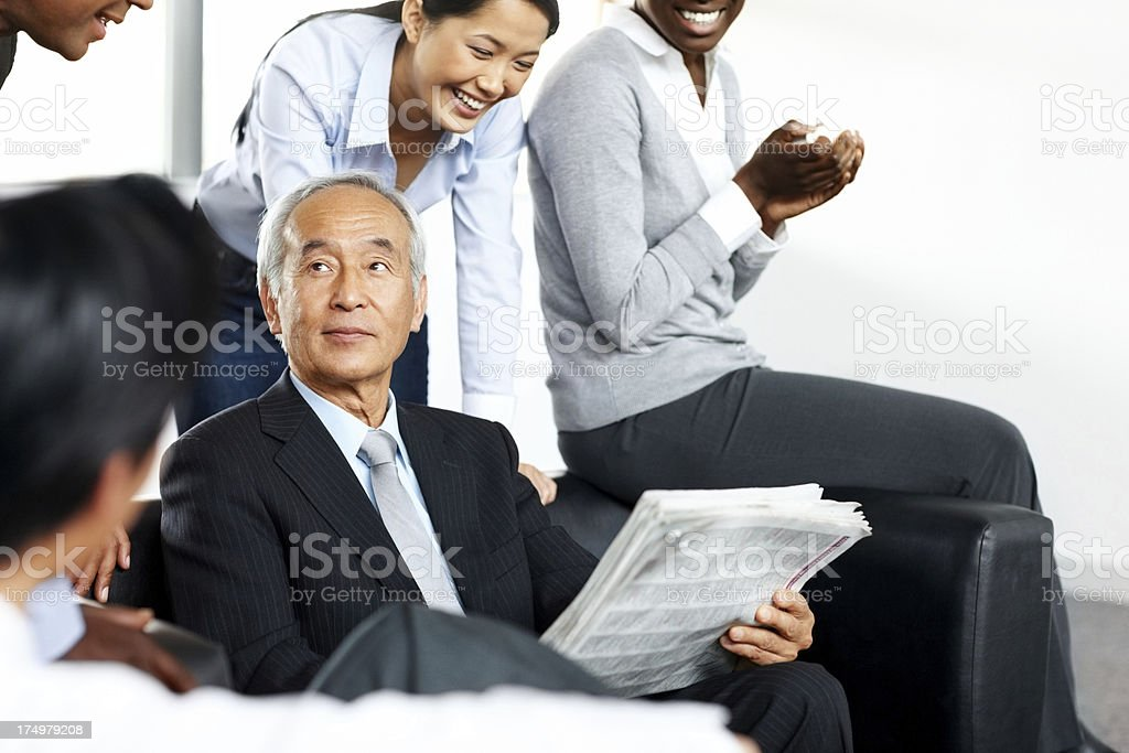Multiracial business group having a friendly discussion during break royalty-free stock photo