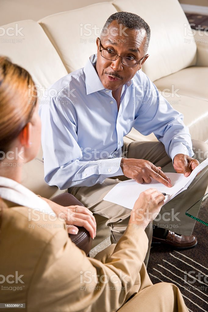 Multiracial business meeting discussing document royalty-free stock photo
