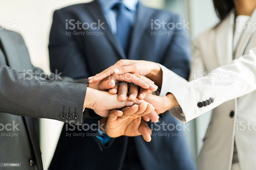 multiracial business people putting their hands together stock photo