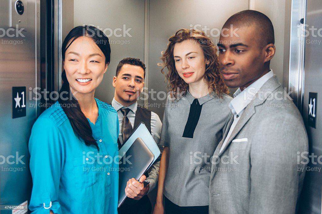 Multiracial Business Team in Elevator stock photo