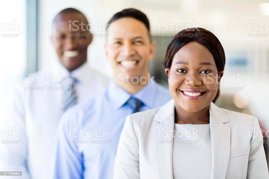 multiracial business team standing in a row stock photo