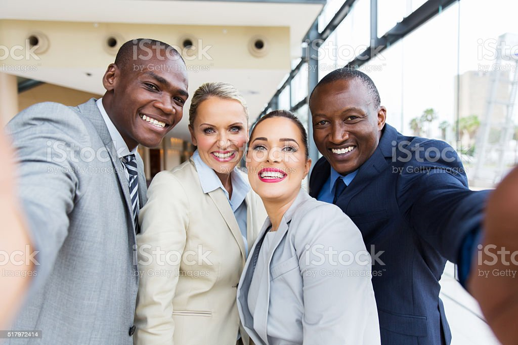 multiracial business team taking selfie together stock photo