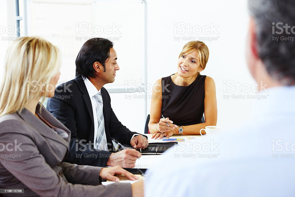 Multiracial business team talking in meeting royalty-free stock photo